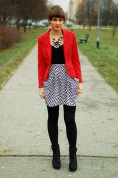 bold; b/w print skirt worn with bright red and opaque black tights, ankle boots