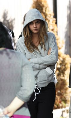The not-so-glamorous side of the movie industry: Cara Delevingne stood idly on the set of ...