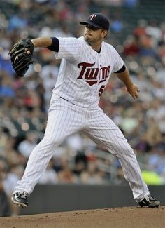 Minnesota Twins pither Brian Duensing throws to a Kansas City Royals batter in the first inning of a baseball game, Friday, June 29, 2012, in Minneapolis