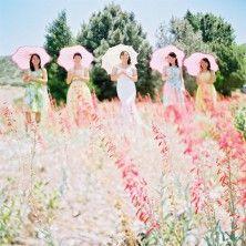 Bride and bridesmaids with parasols