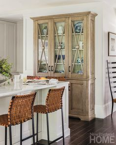 chairs and cabinet (if it were maybe another color?)... A custom kitchen cabinet by Venegas and Company provides a display area for treasured pieces.