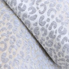 A pretty leopard print fabric in a soft chenille velvet (silver grey) on a soft, pale champagne background.Suitable for medium to heavy upholstery, decorative pillows, seat cushions and other home decor projects.Content:100%PolyesterWidth:57