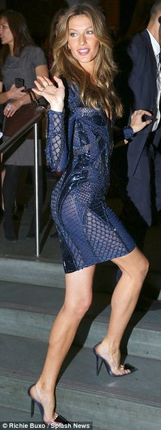 Dressed to impress: Gisele looked incredible in a plunging blue dress at the WSJ Innovator of the Year Awards in New York on Wednesday night...