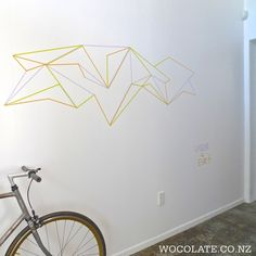 Inspiring DIY Tape Mural for Home Wall Decor - Rockindeco