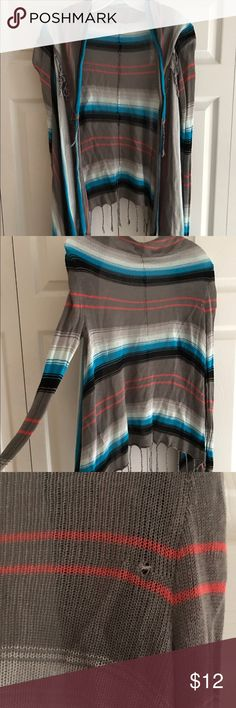 Billabong slouchy cardigan Striped cardigan with tassels along the hem. Has small hole in the back. See last picture. Billabong Sweaters Cardigans
