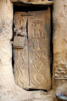 Africa | Dogon door with a carved door lock depicting a man on a horse (could also be a donkey). Dogon country, Mali.