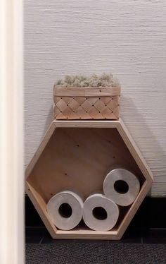 Hexagonal box on its side for TP storage