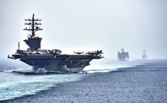 Ike and entourage. USS Dwight D. Eisenhower (CVN-69) followed by the fast combat support ship USNS Arctic (T-AOE 8) and USS Nitze (DDG-94), transit the tight quarters of the Strait of Hormuz. July 2016. USN Photo. [4633 × 2850]