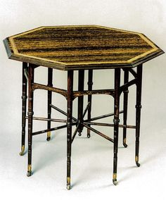Table. Godwin (design), Collinson & Lock (manufacture). C. 1878. Macassar ebony with graining and rosewood, ivory inlay and brass castors. See No. 12, H. Blairman & Sons, 2008.