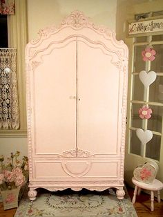 Pretty pink armoire.