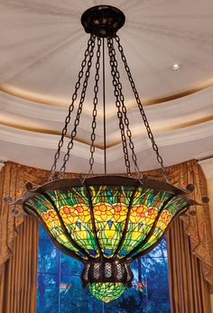 "Replica by artisans Ferrari Studios and Schaeffer Stained & Beveled Glass of Louis Comfort Tiffany ""Daffodil"" chandelier. Photo by Nick Shirghio"