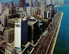 Late 60u0027s View Of The Holiday Inn Lake Shore Drive In Downtown Chicago. The  Blue Peaked Building In Back Of It Is The American Furniture Mart.