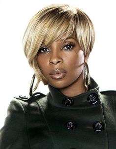 Mary J. Blige... I am so tired of my boring hair....maybe this??