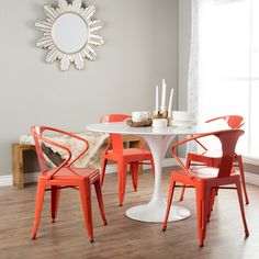 With a beautiful tangerine color, these stacking chairs will add a colorful touch to any space. Fully assembled, this set of four chairs features a lovely scratch resistant finish.
