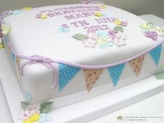 Naming ceremony/christening cake.  Square cake with edible bunting and spring flowers