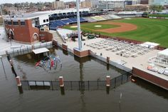 How Historic Stadium Keeps the Mississippi Floods Out - Modern Woodmen Park #davenport #iowa.  Home to Quad Cities River Bandits