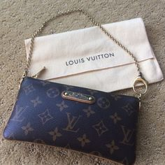 Louis Vuitton milla clutch mm This is one of my favorite little bags. You can move the chain to make it a wristlet or wear it over your shoulder. Great condition. Includes the original duster. Perfect for phone, cles key holder and cash. Louis Vuitton Bags Clutches & Wristlets