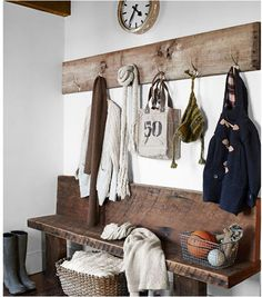 entryway for enclosed porch. Rough cut lumber bench and coat rack