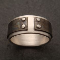 Mind The Gap: a ring in sterling silver and titanium. $84.00, via Etsy.