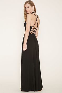 This knit maxi dress is complete with a V-neckline, cami straps, and a lace-up back with high polish grommets.
