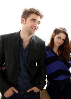 Robsten Dreams: Robsten Pic of the Day ~ Rob's smile with Kristen's smirk are so adorable. And love the way her fingers curl around his back. -- BD2 Press Junket, Nov 2012