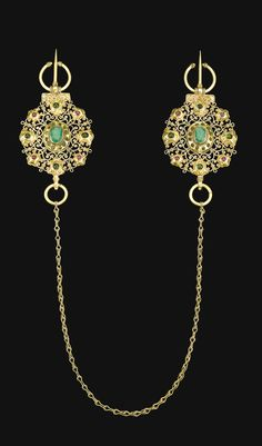 A GEM-SET GOLD FIBULAE (KHALLALAT), MOROCCO, 18TH CENTURY comprising two gold openwork roundels linked by a gold chain, each set with rubies, emeralds and coloured stones, fitted with a hook and stud for attachment 61cm. length.