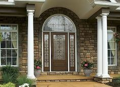 When you have this kind of architectural detail there is no need for excess adornment!  This entry way is exquisite and the planted urns add just  the right touch of colour.  www.thermatru.com