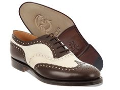 Mod. Dandy Oxford  in full-grain calf leather   combined from two contrasting colors.   Particular seams and monogram at the tip. Sole and heel in leather.