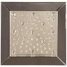 Introduce a luxurious touch to any space with this square crystal wall mirror.