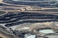 Alberta Canada, oil sands flyover. This is how the oil sands have been harvested since 1967.  Lots of interesting pics.