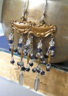 The Cirque earrings - curious and longline, these are comprised of vintage brass, vintage Swarovksi crystals, sterling, goldfill, and violet hued iolite.