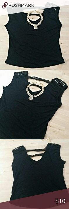 Black Studded Tank Black Studded Tank Top.  Gold cone studs. Cut out V shape in the back that had two mesh attachments. Fun lil black shirt to dress up. Shirt is super soft! Made in USA Tops Tees - Short Sleeve