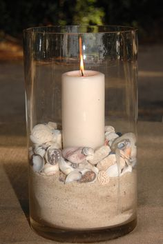 flowerless centerpieces - could use pearls or colored flat marbles instead of shells Flowerless Centerpieces, Beach Theme Centerpieces, Seashell Centerpieces, Centerpiece Ideas, Seashell Candles, Nautical Centerpiece, Quinceanera Centerpieces, Seashell Crafts, Beach Crafts