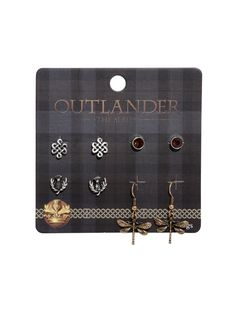 "<div><div>Four sets of earrings that celebrate your love for <i>Outlander</i> with iconic symbols from the show. 3 pairs of burnished silver tone studs include a pair of Scottish thistles, Celtic knots, and gemstones. Also included are a pair of bronze tone dangle Dragonfly earrings.</div></div><ul><li style=""list-style-position: inside !important; list-style-type: disc !important"">Alloy</li><li style&..."