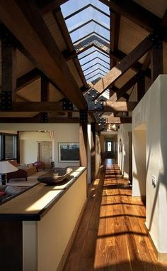 heavy wood beams and columns + an apex skylight along the hallway  interior—style:    interior—style