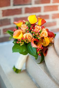 Yellow, peach, red rose, calla lily + hypericum berry bouquet - Traditional Fall Wedding from A.J. Dunlap Photography - via heartloveweddings
