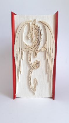 Book Folding Patterns, Pattern Books, Dragon Book, Welsh Dragon, Glass Book, Folded Book Art, Pattern Cutting, Book Show, Easy Drawings
