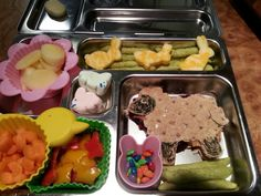 PB shaun the sheep, rainbow sunflower seeds in bunny cup, bell pepper butterflies,  carrot ladybug carrot slices in chick cup, egg apple slices in a flower cup,  cheese chicks, peapod crackers,  and marshmallow bunnies