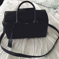 Authentic Yves Saint Laurent black handbag Super classic and chic! Amazing structure and perfect condition Yves Saint Laurent Bags