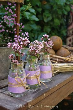 recycle frapacinno jars, cover with material, add twin and faux flowers = cute grouping