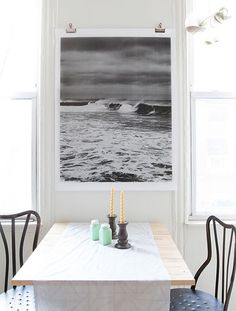 easily hang large wall art, an engineering print with binder clips (via Design Sponge)