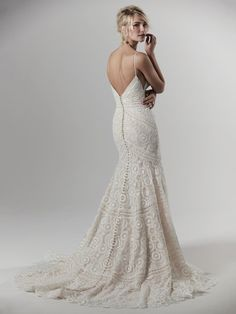 This sexy fit-and-flare boho wedding dress features geometric lace atop tulle, with delicate spaghetti straps completing the illusion plunging neckline and V-back. Finished with zipper closure and covered buttons trailing from back to hem. Making A Wedding Dress, Boho Wedding Dress, Dream Wedding Dresses, Designer Wedding Dresses, Wedding Gowns, Maggie Sottero, Wedding Dresses Photos, Bridal Dresses, Sottero And Midgley Wedding Dresses