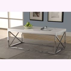 living room-->@Overstock.com - Glossy White/ Chrome Metal Cocktail Table  - A sleek white with chrome metal support, this table is the perfect way to upgrade your home decor. With sturdy legs and a clean, rectangular shape, this table is both functional and stylish.  http://www.overstock.com/Home-Garden/Glossy-White-Chrome-Metal-Cocktail-Table/8280677/product.html?CID=214117 $149.99