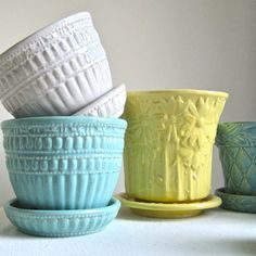 Vintage McCoy planters..love the beaded edge and the quilted pattern the best - have some of both