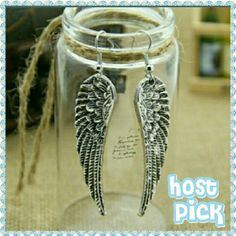 Angel wing earrings ** Host Pick Beautiful silver tone earrings. The wings are just under two inches long. New with tag.  Please do not purchase this listing. I will make a separate listing for you. Thank you.       Pretty, Flirty, Girly host pick by @pinkponee. Go check out her lovely closet. Boutique Chic Jewelry Earrings