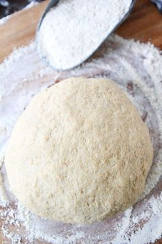 Easy Whole Wheat Pizza Dough Recipe on twopeasandtheirpod.com This healthy whole wheat pizza dough is our favorite and it is easy to make too! Makes perfect pizza every time!