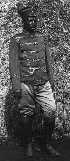 Unknown African wearing a German Hussar Officers  Interim tunic and visor cap.