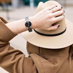 A ceramic watch is the perfect accessory for any time of year! We love how @thefashionbrief paired it with a cute hat and winter coat for the perfect cold weather look! #armitron #onewatchmanyfaces #tiptuesday #blackandgold #coldweather