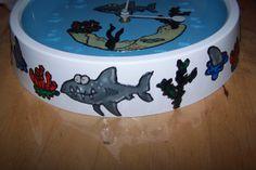 Klok met haaien van glasverf