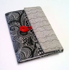 Jr. Legal Pad Folio Cover is covered in 2 coordinating Black & White and Gray patterns. Accented with a red button and elastic to keep the cover in place when not in use. Inside left cover has a pocket for cards, papers and I keep my pen clipped to the pocket. $25.00
